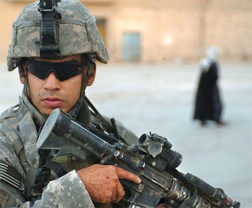 1st Lt. Ruben Burgos, from the 82nd Airborne Division, provides security while his team searches for improvised explosive devices in Tal Afar, Iraq.