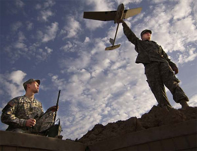 Spc. Ted Trenary and Pfc. Kevin Tirserio (right), from the 101st Airborne Division, prepare to launch the Raven unmanned aerial vehicle at Forward Operating Base McHenry, Iraq. The Raven is being used to hunt for roadside bombs.