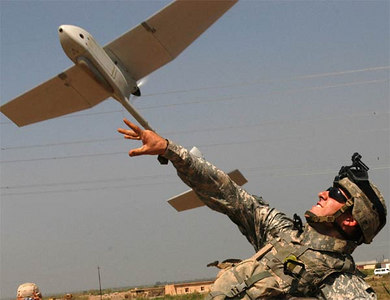 Pfc. Josh Kendrick, from Company C, 1st Battalion, 66th Armor Regiment, 1st Brigade Combat Team, 4th Infantry Division, launches the Raven, an unmanned aerial vehicle, to provide area reconnaissance during Operation Bold Action near Tarmiya, just north of Baghdad.
