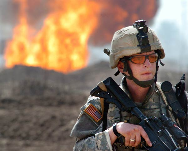 Staff Sgt. Dave Fitzgerald, from the 1st Brigade Combat Team, 4th Infantry Division, maintains perimeter security at the site of an insurgent attack on an oil pipeline near Taji, Iraq.