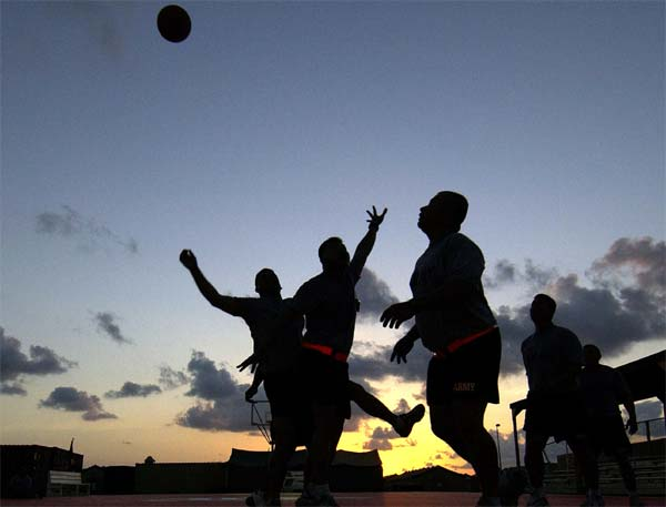 Soldiers from Company B, 1st Battalion, 294th Infantry Division, stay in shape playing basketball following their unit physical fitness training, at Camp Lemonier, Djibouti, in Africa, where they are stationed for six months.