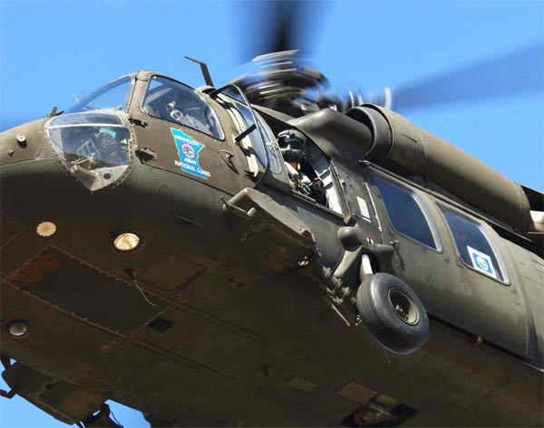 A Minnesota Army National Guard Black Hawk helicopter transports Gov. Tim Pawlenty to view the record flooding of the Red River region along the state's border with North Dakota.