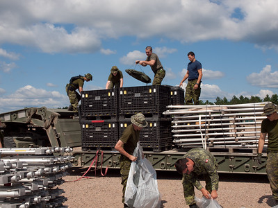Building FOB Warbler, training area at CFB Petawawa.  The trucks left so the members had to hand bomb the tents.