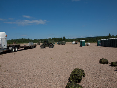 Building FOB Warbler, training area at CFB Petawawa.  As the drivers said they had orders to drop the one truck and head back. We told them over and over that there were a lot of trucks to unload. Unfortunately they had their order, they wanted to stay but had to obey. The last pallet is about to be unloaded and they will leave us forever when two more show up with full loads. We did not even have to ask, they unloaded both of these trucks as well. Whew...