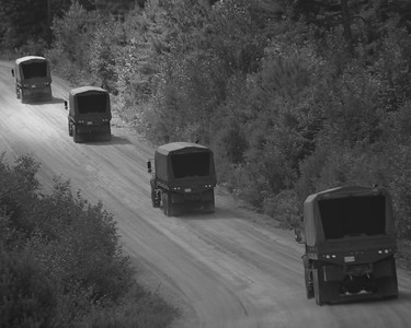 Convoy to get the troops. I was in the last vehicle descending a hill and the rest are heading up a new hill. This road is very hilly and winding with gravel and washboard and average speeds of 30 to 40 kph (10 to 20 mph).  Arrowhead Storm 11, CFB Petawawa