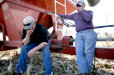 Arnie and Nate Ralston wait for a delivery truck to pick up a load of their corn at some of the Ralston's farm land located on IL route 130 about ten miles south of Charleston, Illinois on Saturday, November 1, 2008.  When they have to wait, that means less time in the field. (Jay Grabiec/Staff Photographer)
