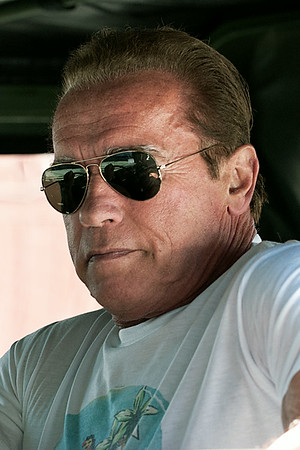 Arnold Schwarzenegger drives his Veggie Hummer