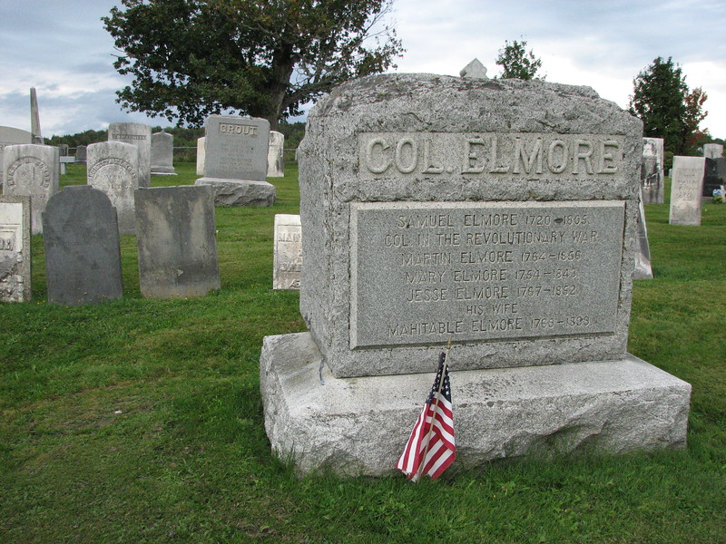 Samuel Elmore's original gravestone is the gray arch-topped one at the left in this photo. It is situated one row behind, and to the left of the modern stone.