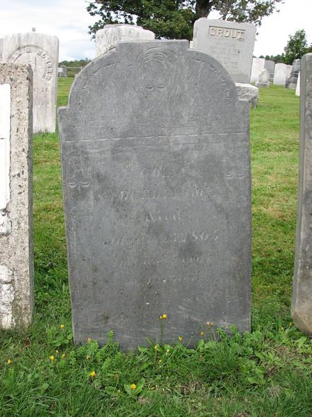 Elmore's original gravestone