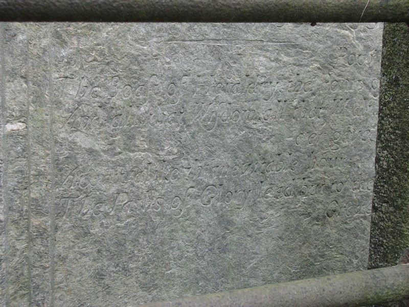 Lower part of the inscription on Foster's gravestone