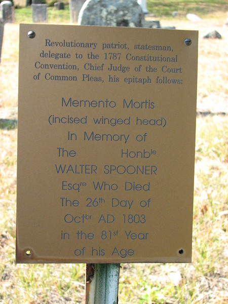 The bronze plaque at the grave