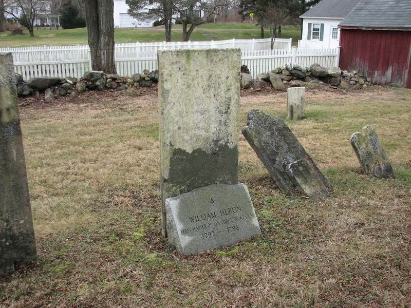 View of the back of the gravestone, with a small Masonic marker