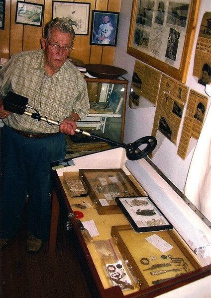 Another view of Mr. Wing and the case displaying Arnold Trail artifacts.