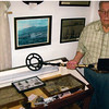 The late Mr. Duluth (Dude) Wing, posing with his metal detector and artifacts he recovered along the Arnold Trail.
