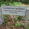 Along the riverside trail, this sign directs one to a shortcut to the cemetery and the Father Rasle monument.