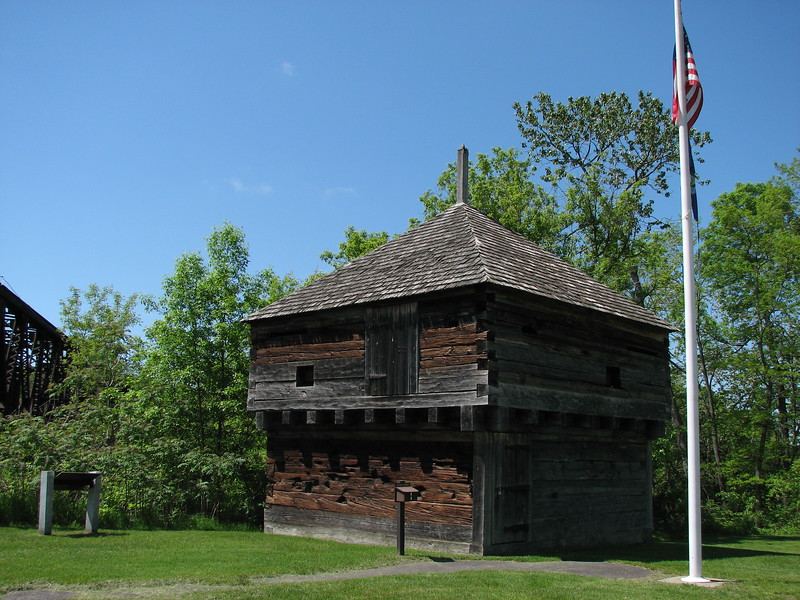 View of the blockhouse as it appears today. It is all that remains of a formerly extensive fortification on this point. This structure was washed away during a great flood April 1, 1987, and after a search, many of the timbers were recovered, brought back, and reassembled on the site.