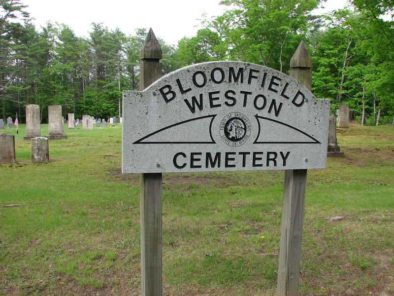 Sign at the cemetery, which sits well back from the present road.