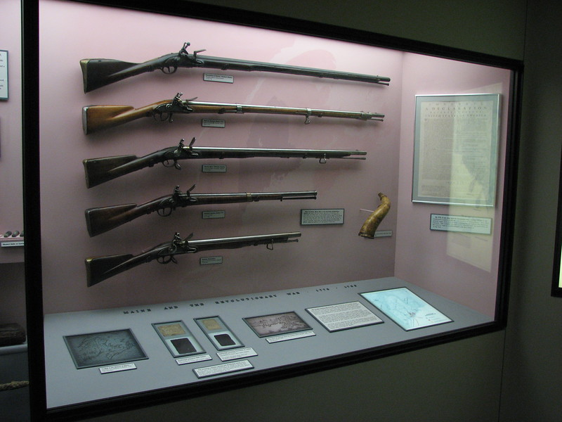 This is the Revolutionary War display. The Arnold Expedition is mentioned on the map displayed at the right on the horizontal shelf, which will be shown in the next  photo.
