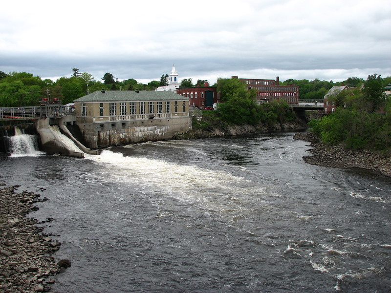 View of the falls from the footbridge just downriver. Both cataracts have since been dammed. Only one can be seen as the other is some ways up the channel that veers to the right and out of view. The portage route was up the cliff between the two falls, perhaps near the point just to the right of the beige powerplant building.