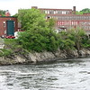 Zoomed view of the area where the portage route ascended the cliff onto the island. The brick building with a red truck parked behind it is Skowhegan Fire Department, 16 Island St.