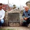 The marker in its former location, next to the fire station, taken in the early 1990s.