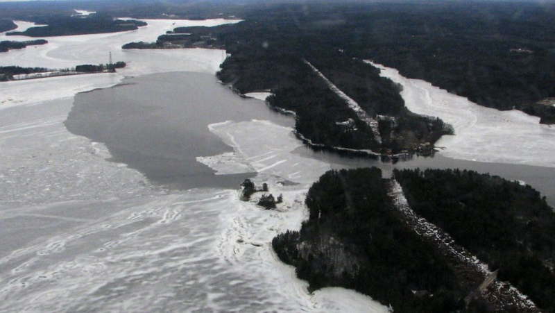 This newspaper photo shows the constriction that the entire flow of the Kennebec, Androscoggin and several smaller rivers must pass through (the small gap between the two headlands) to continue as the Kennebec River to the sea. The river flows left to right in this photo. My photos which follow were taken from the shore of the further headland, across the gap to the closer headland.