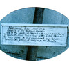 Sign on Tracy's grave, as seen in the 1990s. It is unreadable today.