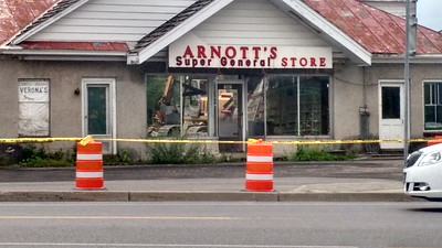 Leah McDonald - Oneida Daily Dispatch The closed and vacant Arnott's Super General Store on Route 31 in Verona is torn down on Tuesday, June 28, 2016.