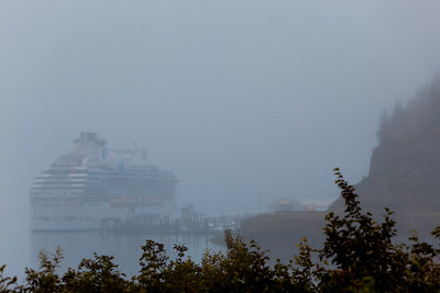 A foggy greeting from Whittier Alaska after exiting the single lane tunnel shared by both trains and autos.