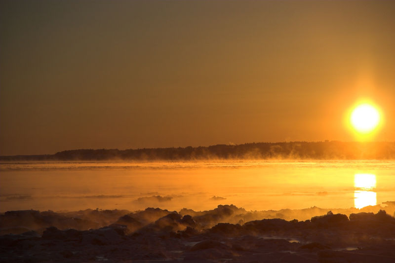 Cold sunset.<br /> Steam rises from warm water and adds a nice effect.