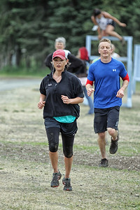 Michelle leads Brendan Roberts to the mud pit..
