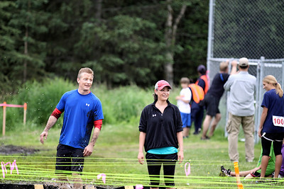 Brendan & Michelle Roberts face the water pit at the finish line ..