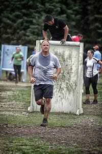 Peter Seiffert leads Jesse Keaveny over the wall ..