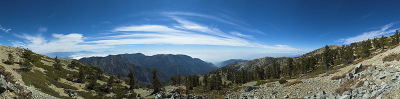 """Thunder Mountain, Telegraph Peak, Bighorn Peak, Cucamonga Peak and Ontasrio Peak from the top of the Baldy Bowl Trail on San Antonio Peak with San Gorgonio and San Jacinto in the left distance.  <a href=""""http://www.dbdimages.com/photos/101926186_4aN5x-O.jpg""""TARGET=""""blank"""">View large in another window.</a> Use your viewer's zoom function if necessary and be sure to use the sliders."""