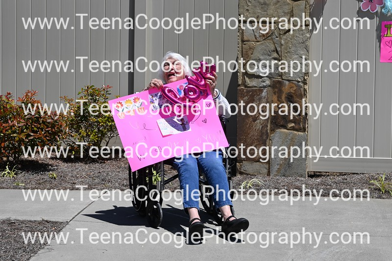 Lee Breckwoldt See next pictures with girls holding pink fuzzy sign
