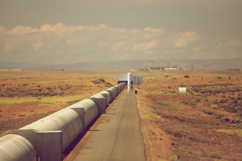 Four kilometers of covered vacuum'ed pipes with the Hanford waste facility cranes in the distance.
