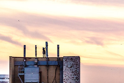 Communications worker on rooftop