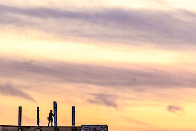 Worker on Rooftop at sunset