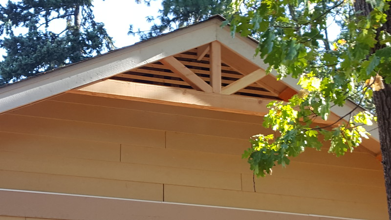 Custom roof vents behind the roof gable treatments