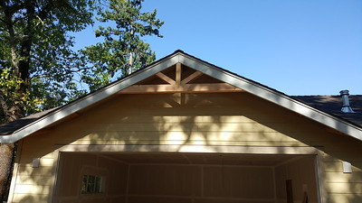 gable treatment over the garage.  no vent under this one