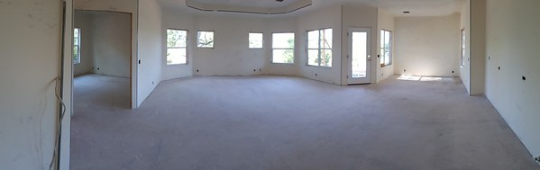 panorama of open concept living.  Office toward the left, living great room in front, exit door to the back porch, dining room, long wall on the right and behind me is the main part of the kitchen, island will be between kitchen and great room.