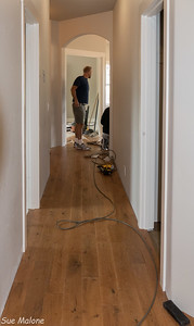 Joel is checking out Jarrod's work on the hardwood.  After it is done, Joel will put in the rest of the baseboard trim