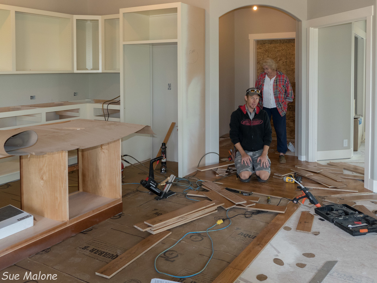 """THe upper cupboards are in! Jarrod is quite the craftsman with the hardwood, very careful and meticulous.  Also plays the guitar in his band """"Into the Sky"""""""