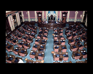 """The House of Representatives Chamber, with 110 members, is the larger of the two chambers. Each representative is elected to a two-year term from a district of about 90,000 constituents. Each member sits at an assigned desk, with Democrats traditionally sitting on the left of the chamber as you face the rostrum and Republicans on the right. The presiding officer is gthe Speaker of the House, a representative elected to his position by fellow members.""   (Taken, from""Your State Capitol"", booklet.)"