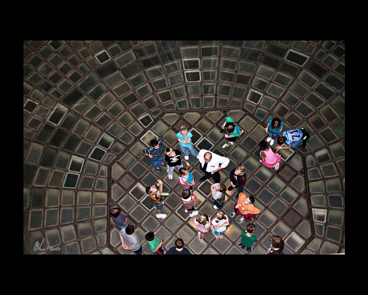 "This is the glass floor of the rotunda, taken from the 3rd floor balcony. A tour by grade school children, was going on while I was there. View the large version of this photo and look at each child and what they are doing. I found it quite interesting.<br /> <br /> ""The floor of the rotunda, which consists of 976 pieces of glass, each about 5/8 inch thick. The floor is 44 1/2 feet in diameter. It's design creates an optical illusion: seen from above it appears that the center of the floor sinks to form a bowl. Lit from below, the Capitol's famous glass floor is one of the most beautiful and memorable sights in the building.<br /> <br /> (Taken, from""Your State Capitol"", booklet.)"
