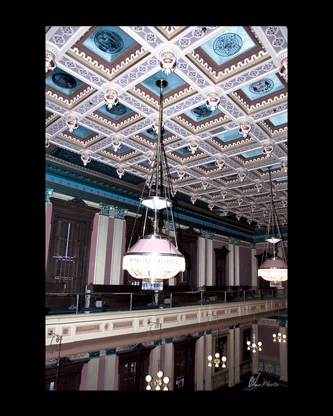 "The ceilings in both the House and Senate Chambers have been restored.<br /> <br /> ""Original panes of ruby-and-white hand etched glass were lost years ago, replaced in the House by plastic and in the Senate by plywood.""<br /> <br /> (Taken, from""Your State Capitol"", booklet.)"