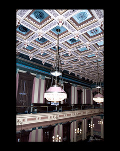 "The ceilings in both the House and Senate Chambers have been restored.  ""Original panes of ruby-and-white hand etched glass were lost years ago, replaced in the House by plastic and in the Senate by plywood.""  (Taken, from""Your State Capitol"", booklet.)"