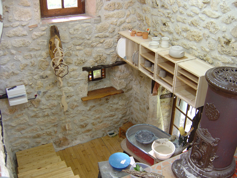 Linda's pottery area.  We moved the old woodburning stove from the old kitchen into her workshop.