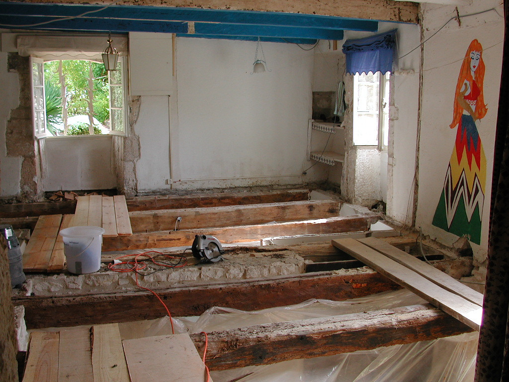 Early renovation work.  This is the second story of the house.  There use to be four small bedrooms and no bathroom.  We converted it to one reasonable size master bedroom and bathroom.  If you fall between the beams you're in the kitchen.