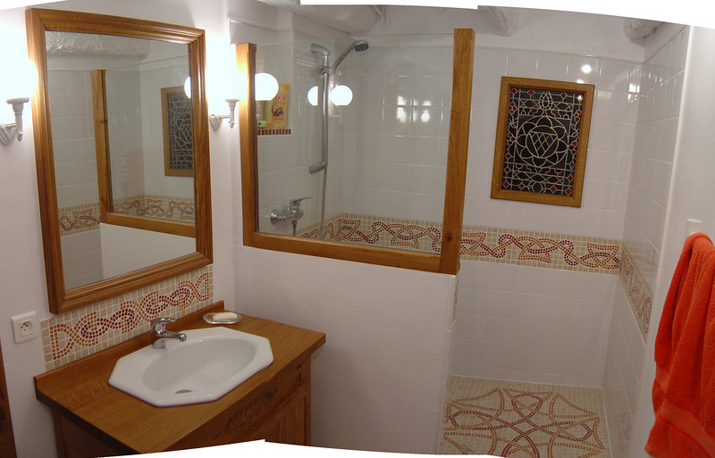 The renovated bathroom downstairs.  Linda cut each tile in the mosaic pattern.  I made all the wooden things.